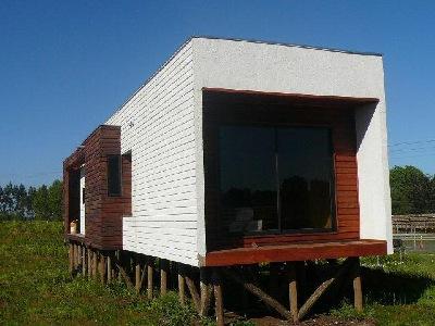 Maderas impregnadas postes y medialunas corraleras for Casas prefabricadas mediterraneas